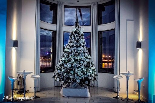 christmas tree standing in the royal liver building ballroom against a backdrop of the River Mersey