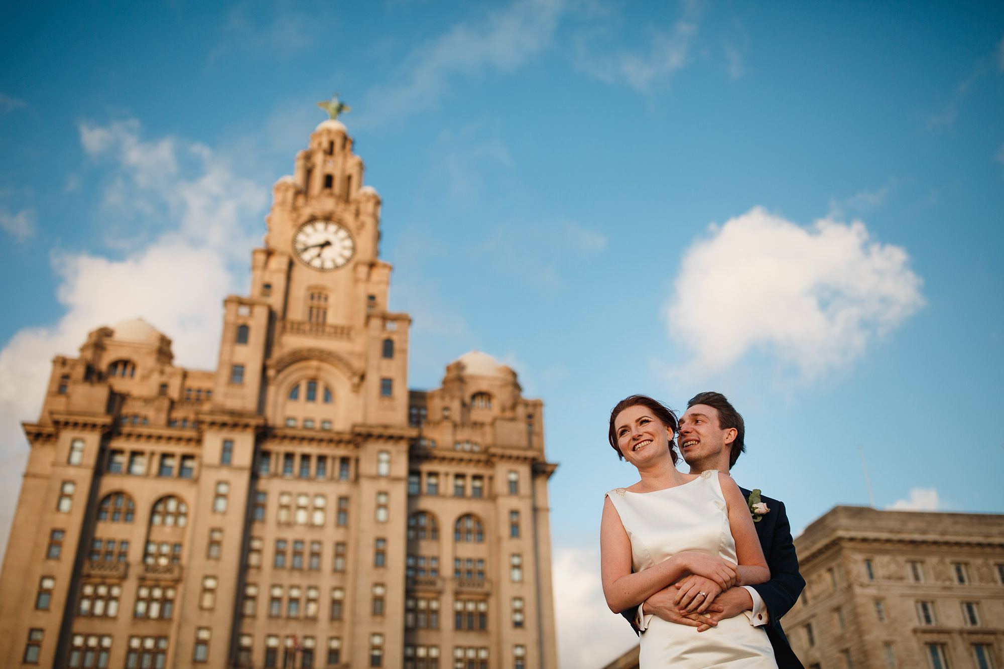 Stephen Walker Wedding Photographer Royal Liver Building Wedding Photography- Bride and Groom Pose in front of Royal Liver Building