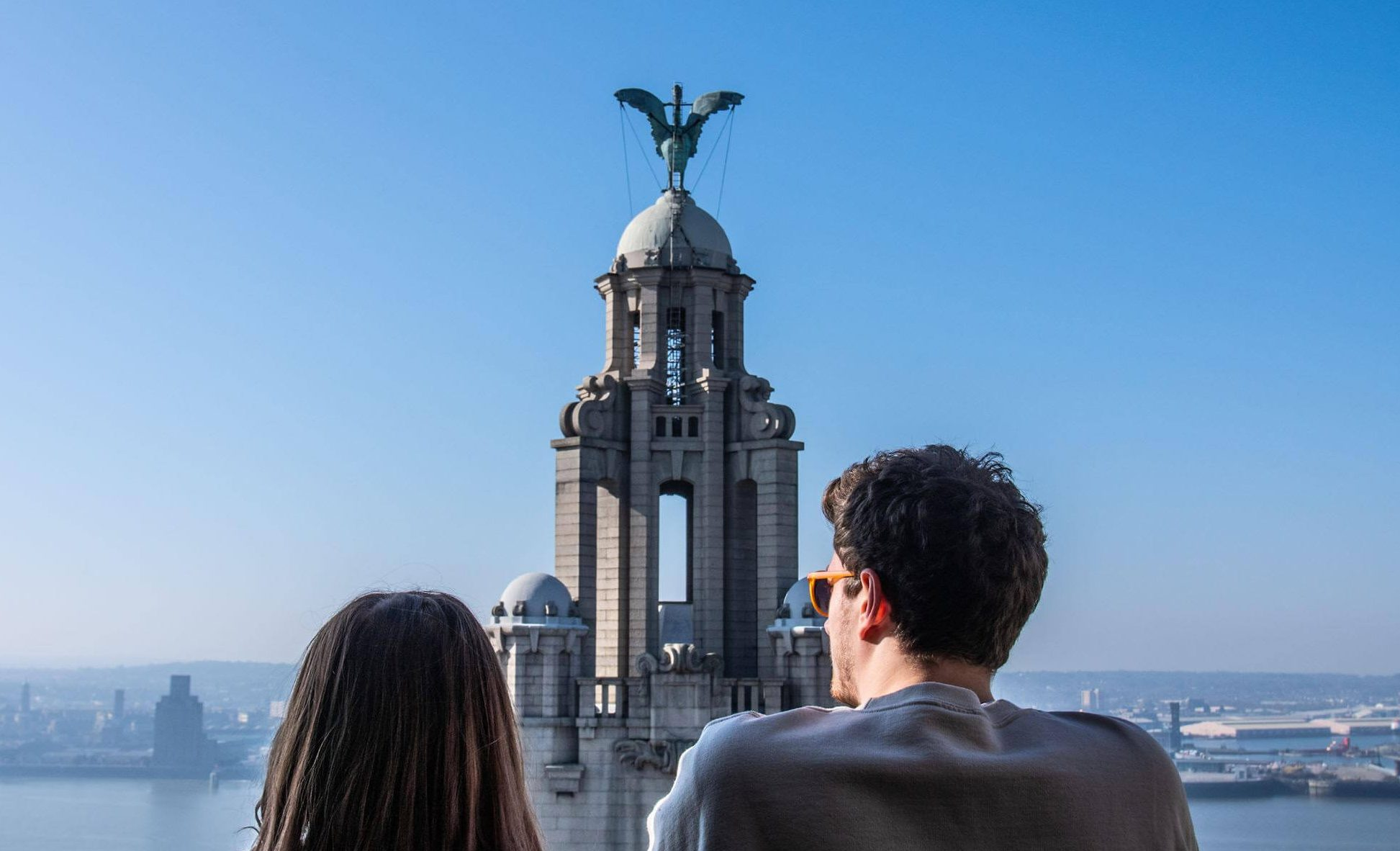 man and woman on the roof of the royal liver building looking over the River Mersey